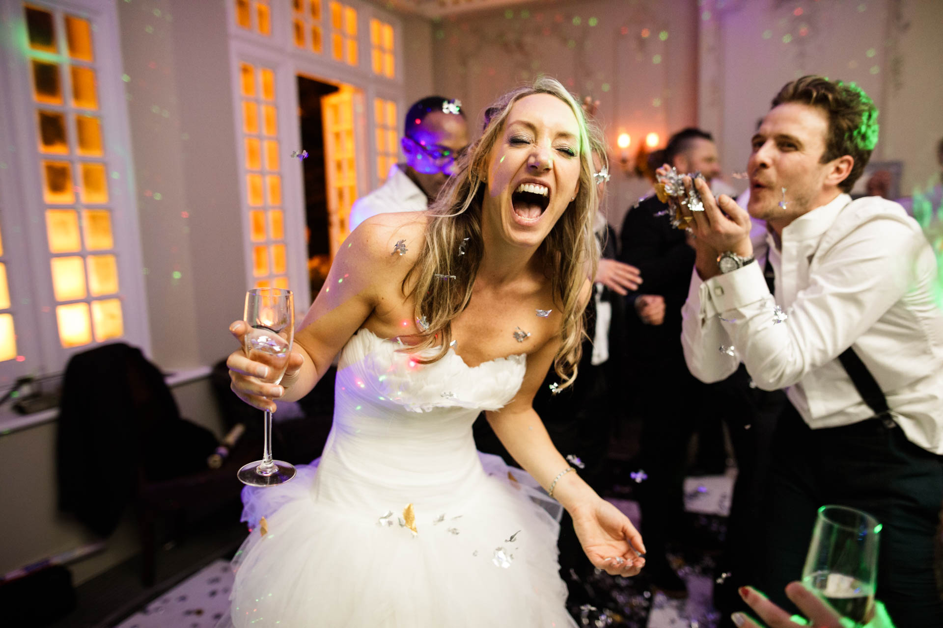 Bride and groom celebrating at their NYE wedding at Chateau Le Chaire, Jersey
